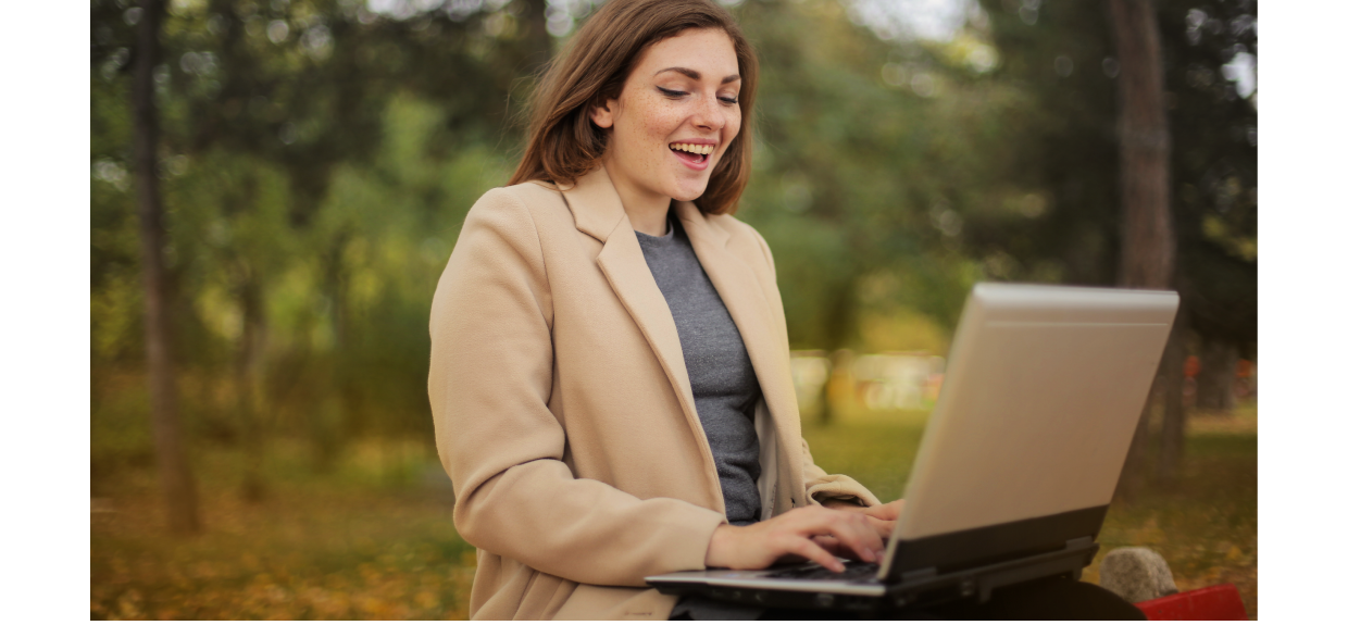 woman with laptop in forest